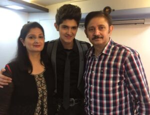 Rohan Mehra with his parents
