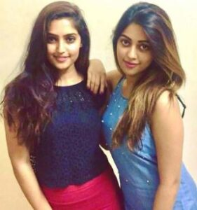 Anu Emmanuel with her sister