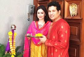 Anjali Tendulkar with her husband