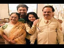 Dev with his family