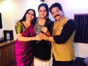 Meghna Mishra with her parents