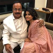 Miss Pooja with her father