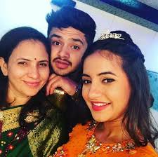 Meera Deosthale with her mother & brother