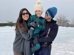 Neha Swami with her husband & son