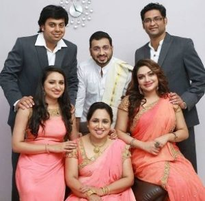 Rimi Tomy with her family