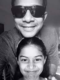 Karthik with his daughter