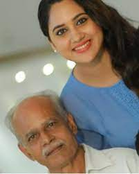 Mia George with her father