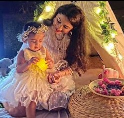 Rucha Hasabnis with her daughter