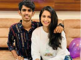 Kinjal Dave with her brother