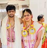 B. Sai Praneeth with his wife