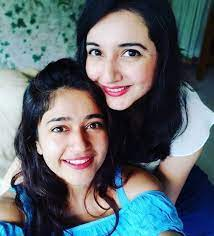 Poonam Bajwa with her sister