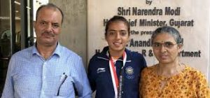 Ankita Raina with her parents