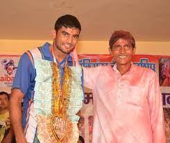 Manish Kaushik with his father