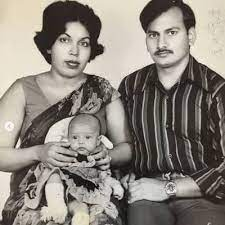 Flora Saini with her parents